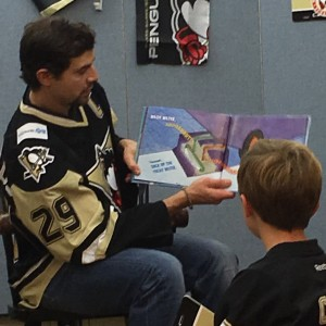 Captain TK reading to the kids this year at the library.
